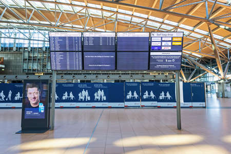 Hamburg, Germany - March 29 2020: Departure board at airport in Hamburg, showing reduced schedule for flights because of coronavirus pandemic Sajtókép