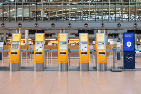 Hamburg, Germany - March 29 2020: Lufthansa self check in machines in the departure terminal, airport in Hamburg, with no passengers around because of the Covid-19 pandemic