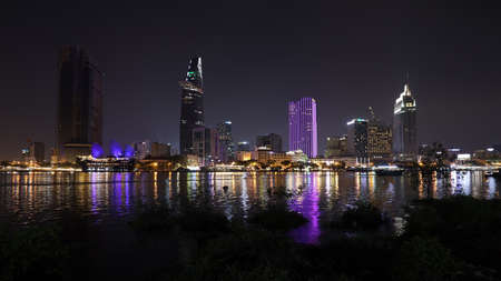 Modern architecture in downtown of Ho Chi Minh City, with river Saigon at nigh