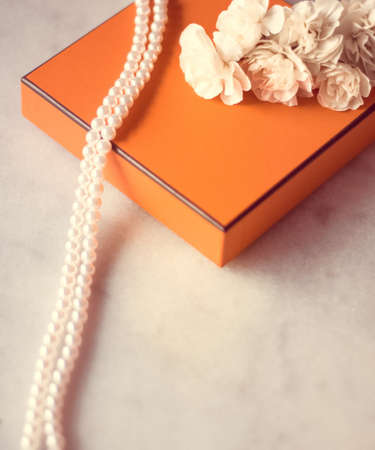 Present box and flowers for her - Mothers day ideas, happy giving and holiday inspiration concept. The perfect gift for mom Reklamní fotografie