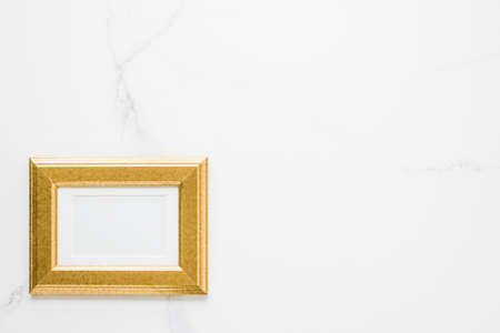 Golden photo frame on marble, flatlay - modern feminine, artwork mock up, luxury design concept. Decorate with chic and style Stock Photo