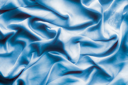 Blue soft silk waves, flatlay - elegant fabric textures, abstract backgrounds and modern pastel colours concept. Feel the touch of luxury