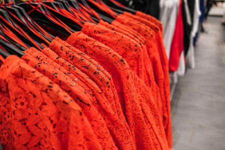 Style, fashion shop and shopping concept - Fashionable casual clothes in a boutique store