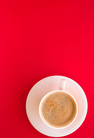 Breakfast, drinks and modern lifestyle concept - Hot aromatic coffee on red background, flatlay