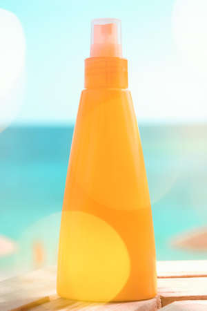Suntan lotion outdoors - summer vacation, travel and body care concept. Protect your skin on the beach