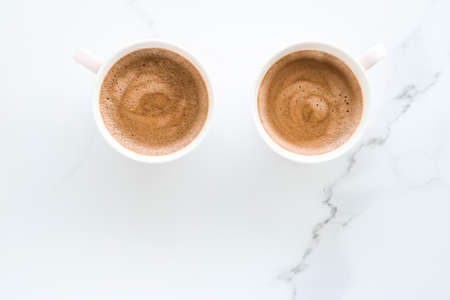Breakfast, drinks and modern lifestyle concept - Hot aromatic coffee on marble, flatlay Stock fotó