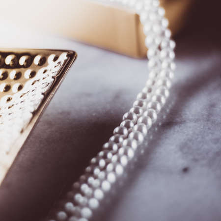 Valentines day ideas, luxury shopping and holiday inspiration concept - Pearl jewellery in a vintage golden gift box Imagens