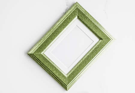 Modern feminine, artwork mock up, luxury design concept. Decorate with chic and style - Green photo frame on marble, flatlay