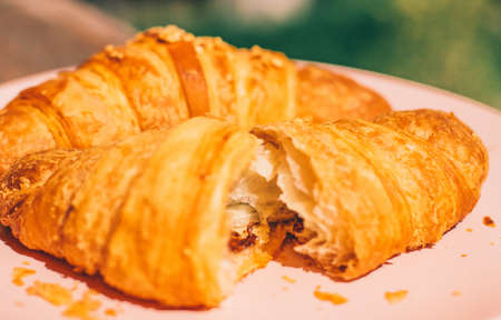 Fresh croissant, summer breakfast outdoors - sweet food, French pastry and eating outside concept. Good morning, darling 版權商用圖片