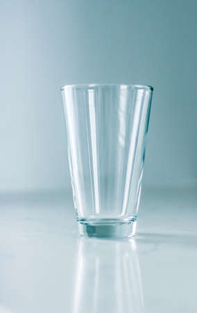 Glassware, washing and purity concept - Clean empty glass on marble table
