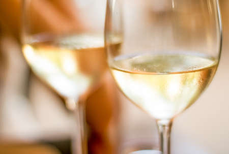 Winery, fine dining and celebration concept - French white wine in a restaurant in Paris, travel experience