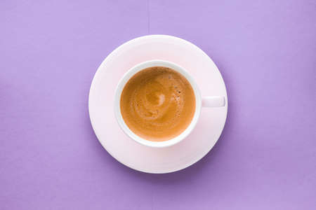 Breakfast, drinks and cafe menu concept - Coffee cup on purple background, top view flatlay Stock fotó