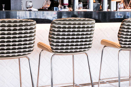 Interior design, furniture decor and nightlife concept - Modern bar stool in a luxury restaurant