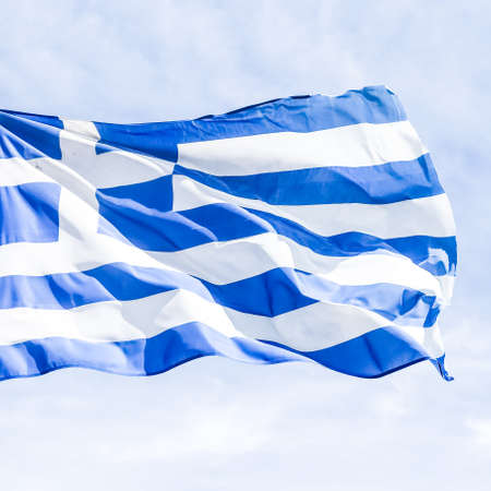 European political news, grexit and nation concept - Greek flag and cloudy sky in summer day, politics of Greece