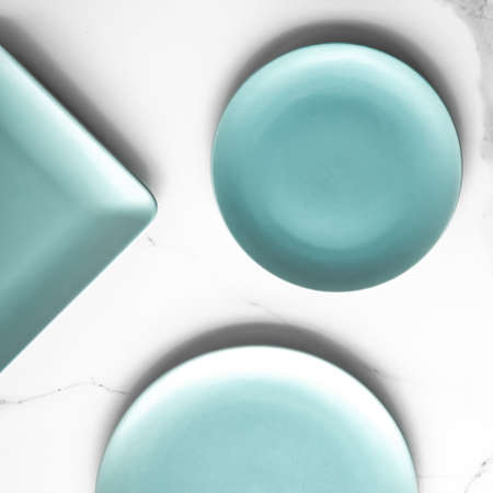 Turquoise empty plate on marble, flatlay - stylish tableware, table decor and food menu concept. Serve the perfect dish