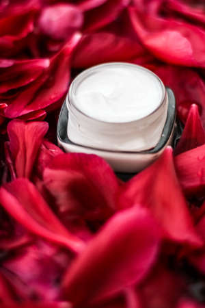 Clean beauty, cosmetic products and luxury body care concept - Sensitive skincare moisturizer cream on red flower petals and water background, natural science for skin