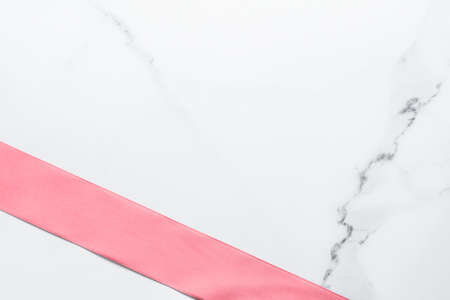 Birthday, wedding and girly branding concept - Coral silk ribbon and bow on marble background, girl baby shower present and glamour fashion gift decor for luxury beauty brand, holiday flatlay design Archivio Fotografico - 132094842