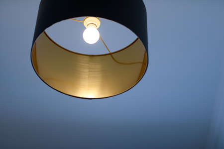 Interior design, indoor lamps and electricity concept - Golden lamp in a room, elegant modern home decor lighting
