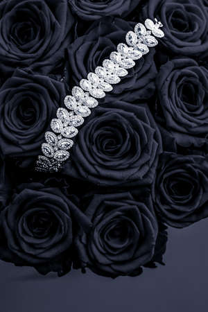 Luxe branding, glamour fashion and boutique shopping concept - Luxury diamond jewelry bracelet and black roses flowers, love gift on Valentines Day and jewellery brand holiday background design