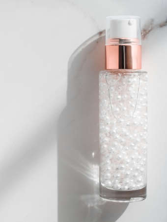 Cosmetic branding, packaging and make-up concept - Skin care serum and gel bottle, moisturizing lotion and lifting cream emulsion on marble, anti-age cosmetics for luxury beauty skincare brand design