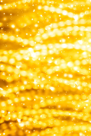 Golden Christmas lights, New Years Eve fireworks and abstract texture concept - Glamorous gold shiny glow and glitter, luxury holiday background
