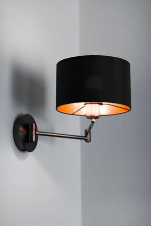 Interior design, indoor lamps and electricity concept - Bronze lamp in a room, elegant modern home decor lighting