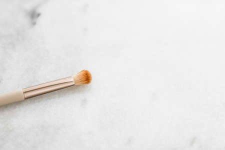 Cosmetic branding, blog and girly concept - Make-up brush for foundation base face contouring on marble background, mua cosmetics as glamour makeup artist product for luxury beauty brand art design