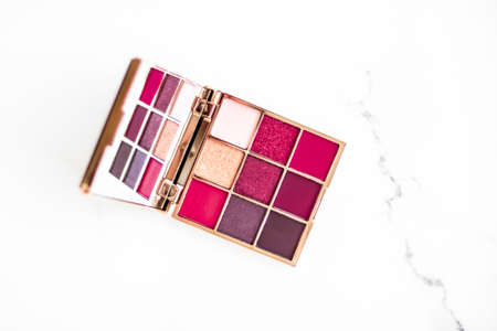 Cosmetic branding, fashion blog and glamour set concept - Eye shadow palette swatches on marble background, make-up and eyeshadows cosmetics product for luxury beauty brand and holiday flatlay design Stock Photo
