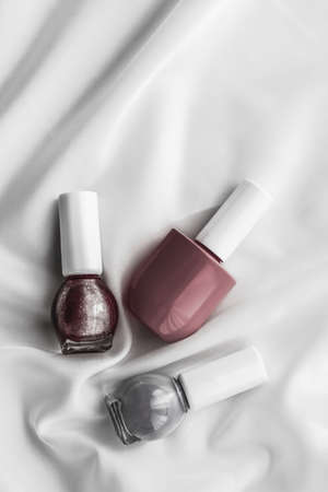 Cosmetic branding, salon and glamour concept - Nail polish bottles on silk background, french manicure products and nailpolish make-up cosmetics for luxury beauty brand and holiday flatlay art design 写真素材 - 133606809