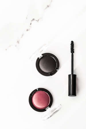 Cosmetic branding, blog and girly concept - Eyeshadows, black liner and mascara on marble background, eye shadows cosmetics as glamour make-up products for luxury beauty brand, holiday flatlay design