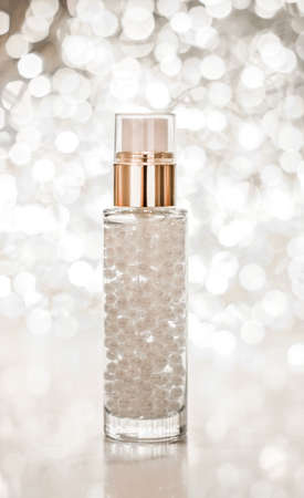 Cosmetic branding, blank label and glamour present concept - Holiday make-up base gel, serum emulsion, lotion bottle and silver glitter, luxury skin and body care cosmetics for beauty brand ads Imagens