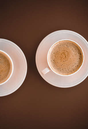 Drinks menu, italian espresso recipe and organic shop concept - Cup of hot coffee as breakfast drink, flatlay cups on brown background Imagens