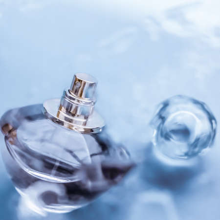 Perfumery, cosmetics and branding concept - Perfume bottle under blue water, fresh sea coastal scent as glamour fragrance and eau de parfum product as holiday gift, luxury beauty spa brand present