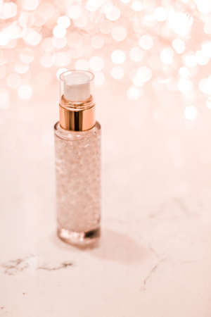 Cosmetic branding, blank label and glamour present concept - Holiday make-up base gel, serum emulsion, lotion bottle and rose gold glitter, luxury skin and body care cosmetics for beauty brand ads