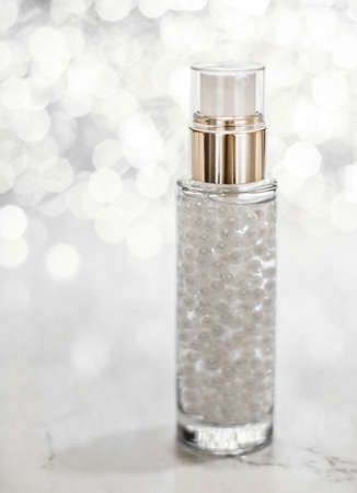 Cosmetic branding, blank label and glamour present concept - Holiday make-up base gel, serum emulsion, lotion bottle and silver glitter, luxury skin and body care cosmetics for beauty brand ads Stock Photo