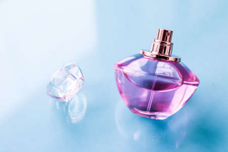 Perfumery, spa and branding concept - Pink perfume bottle on glossy background, sweet floral scent, glamour fragrance and eau de parfum as holiday gift and luxury beauty cosmetics brand design