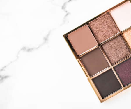 Cosmetic branding, fashion blog and glamour set concept - Eye shadow palette swatches on marble background, make-up and eyeshadows cosmetics product for luxury beauty brand and holiday flatlay design