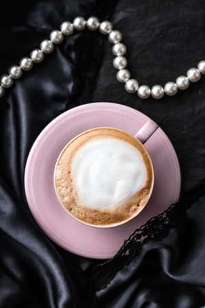 Menu, branding and recipe concept - Cup of cappuccino for breakfast with satin and pearls jewellery background, organic coffee with lactose free milk in parisian cafe for luxury vintage holiday brand Foto de archivo - 135475001