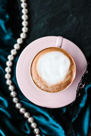 Menu, branding and recipe concept - Cup of cappuccino for breakfast with satin and pearls jewellery background, organic coffee with lactose free milk in parisian cafe for luxury vintage holiday brand Foto de archivo - 135476156