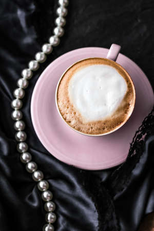 Menu, branding and recipe concept - Cup of cappuccino for breakfast with satin and pearls jewellery background, organic coffee with lactose free milk in parisian cafe for luxury vintage holiday brand Foto de archivo - 135476168