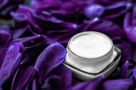 Cosmetic branding, moisturizing and anti-age - Luxury face cream moisturizer for facial skin on purple flower background, floral essense, spa cosmetics and beauty emulsion for skincare brand product