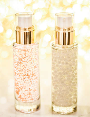 Cosmetic branding, blank label and glamour present concept - Holiday make-up base gel, serum emulsion, lotion bottle and golden glitter, luxury skin and body care cosmetics for beauty brand ads
