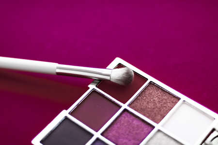 Cosmetic branding, mua and girly concept - Eyeshadow palette and make-up brush on cherry background, eye shadows cosmetics product for luxury beauty brand promotion and holiday fashion blog design