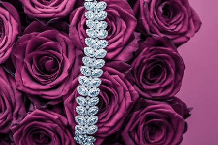 Luxe branding, glamour fashion and boutique shopping concept - Luxury diamond jewelry bracelet and pink roses flowers, love gift on Valentines Day and jewellery brand holiday background design