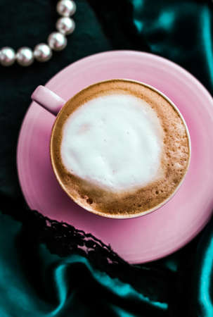 Menu, branding and recipe concept - Cup of cappuccino for breakfast with satin and pearls jewellery background, organic coffee with lactose free milk in parisian cafe for luxury vintage holiday brand Foto de archivo - 135479257