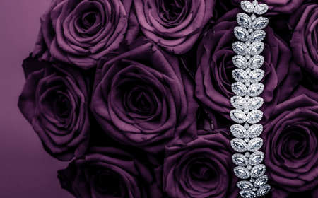 Luxe branding, glamour fashion and boutique shopping concept - Luxury diamond jewelry bracelet and purple roses flowers, love gift on Valentines Day and jewellery brand holiday background design
