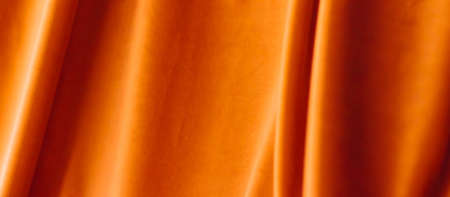 Decoration, branding and surface concept - Abstract orange fabric background, velvet textile material for blinds or curtains, fashion texture and home decor backdrop for luxury interior design brand