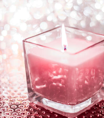 Festive decoration, branding and aromatherapy spa concept - Rose aromatic candle on Christmas and New Years glitter background, Valentines Day luxury home decor and holiday season brand design