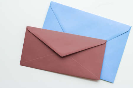 Postal service, newsletter and greeting card concept - Blank paper envelopes on marble flatlay background, holiday mail letter or post card message design