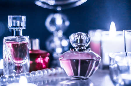 Perfumery, cosmetics branding and luxe concept - Perfume bottle and vintage fragrance on glamour vanity table at night, pearls jewellery and eau de parfum as holiday gift, luxury beauty brand present